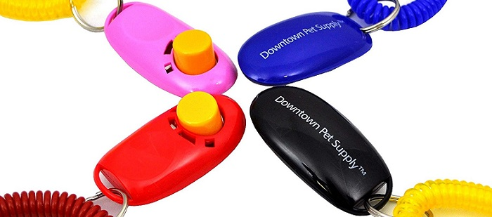 four colorful dog clickers
